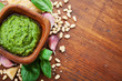 Italian green pesto sauce with ingredients top view. Healthy and organic food.