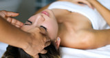 Young woman getting a head massage in a spa - 211508870
