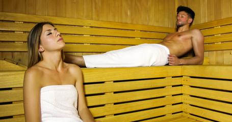 Couple relaxing in a sauna © Minerva Studio