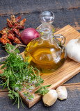 Aromatic fresh kitchen herbs, garlic, onion and olive oil, main ingredients for many dishes in medditerranean cuisine - 211512674