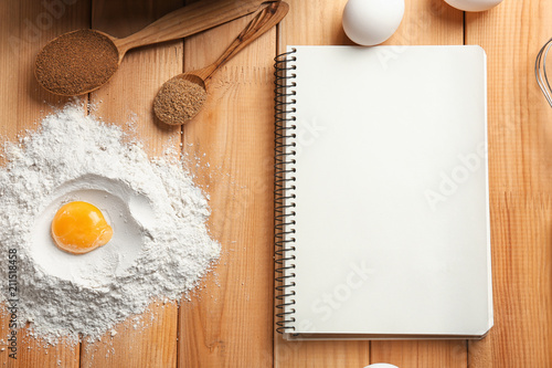 Canvas Kruiden 2 Notebook and ingredients for homemade bread on wooden background