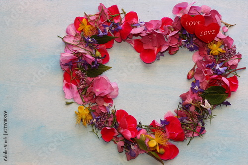 Pretty heart of flowers. Floral frame.