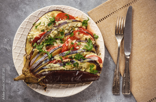 Fototapeta Roasted eggplant fan with mozzarella, tomatoes and parsley.