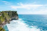 View of the cliff with waves in the sea from The Hindu Temple Pura Luhur Uluwatu, Pecatu, South Kuta, Badung Regency, Bali, Indonesia