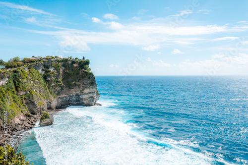 Fotobehang Bali View of the cliff with waves in the sea from The Hindu Temple Pura Luhur Uluwatu, Pecatu, South Kuta, Badung Regency, Bali, Indonesia