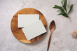Leinwanddruck Bild - minimalist food or restaurant related branding mock-up with stack of business cards on a wooden plate