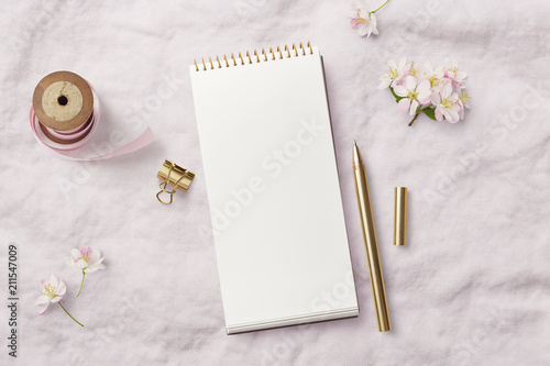 romantic feminine mockup with open / blank notebook, pink ribbon, writing supplies and cherry flowers on a soft linen background, top view - 211547009
