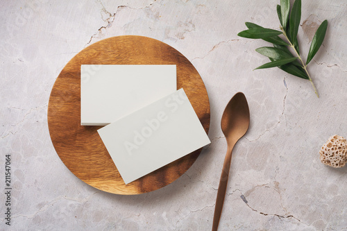 minimalist food or restaurant related branding mock-up with stack of business cards on a wooden plate - 211547064