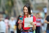 Teenage tourist searching destination online