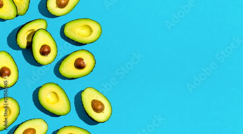 Fresh avocado pattern on a blue background flat lay - 211562665