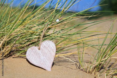 Leinwanddruck Bild Herz im Sand