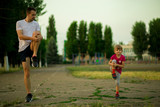 Athletic young father and little daughter do exercises in stadium. Healthy lifestyle - 211578483
