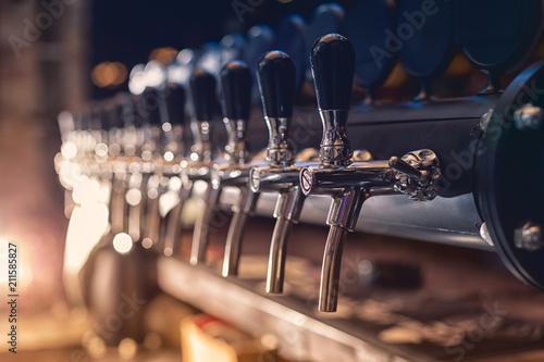 Fototapeta Beer tap in the row