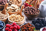 Different sorts of breakfast cereal products and fresh fruits - 211588040