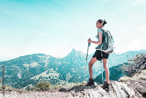 Leinwanddruck Bild Athletic fit young woman hiking in the mountains
