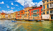 Venice, Italy. Motorboat floating by Grand Canal among antique
