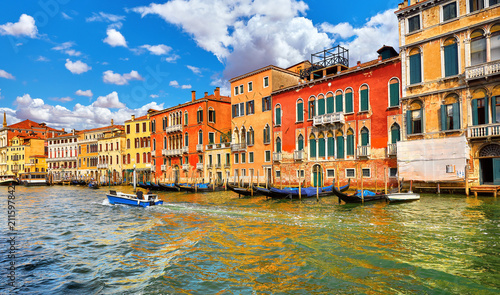 Venice, Italy. Motorboat floating by Grand Canal among antique - 211597842