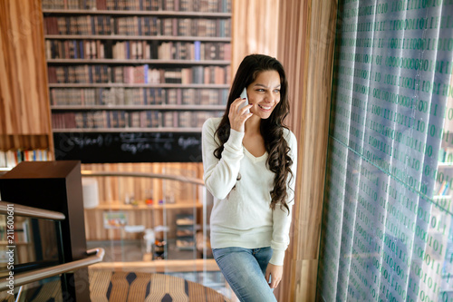 Brunette businesswoman talking on phone