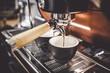Leinwanddruck Bild - Espresso poruing from coffee machine at cafe