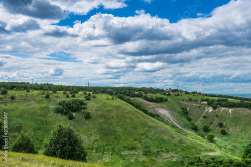 Aluminium Lente Beautiful summer landscape - hills and beautiful blue sky with clouds on the horizon