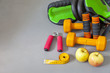Sports equipment, apples and measuring tape on a gym mat. Fitness at home. Healthy lifestyle