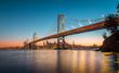 Leinwanddruck Bild - San Francisco skyline with Oakland Bay Bridge at sunset, California, USA