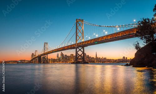 Leinwanddruck Bild San Francisco skyline with Oakland Bay Bridge at sunset, California, USA