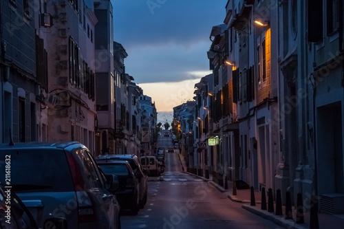 Fotobehang Smalle straatjes mahon at night, menorca, spain