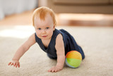 childhood, kids and people concept - lovely redhead baby girl with toy ball at home - 211620023