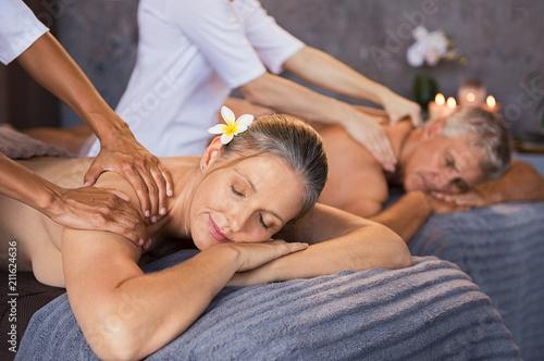 Leinwanddruck Bild Mature couple having massage at spa