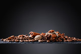 Roasted coffee beans with spices . - 211628061