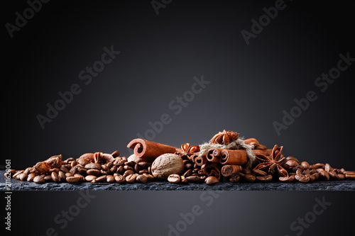 Roasted coffee beans with spices .