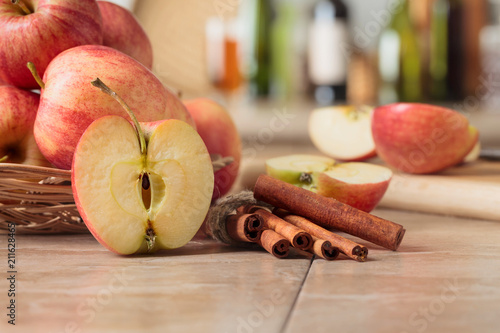 Juicy apples on a kitchen table - 211628465