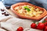 French Tartiflette Recipe Bacon, Potato and Reblochon Cheese Gratin - 211629465