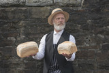 1940s old fashioned baker delivering bread outdoors  - 211629835