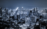 scenic of dark night urban cityscape lighting up metropolis