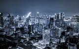 scenic of dark night urban cityscape lighting up metropolis - 211632008