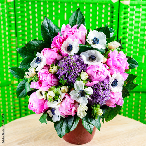 Beautiful bouquet with fresh pink peonies and white flowers in t - 211635678