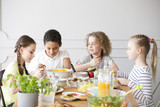 Group of children eating healthy dinner at friend's home - 211636469