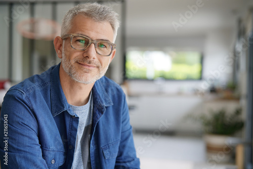 canvas print picture Middle-aged guy with eyeglasses and blue shirt