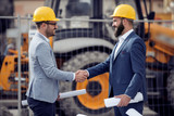 Two engineers shaking hands - 211655619