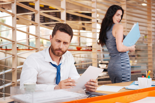 My lover. Delighted beautiful woman looking at her boss while working