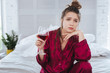 Lonely woman. Lonely emotional woman feeling impassioned wearing pajama drinking alcohol alone