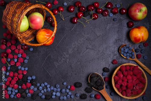 Delicious ripe fruits and berries on black background, close-up. Fruit banner. Selection of healthy vegetarian food, detox or diet concept, space for text. View from above, top studio shot - 211676097