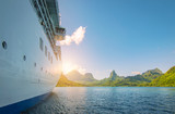 Side view of anchored cruise ship at sunset. Mountain background. - 211676283