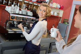Waitress in cafe talking to client - 211683482