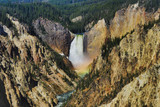 A rainbow forms in the mist of the lower falls of the Yellowstone river in Wyoming.  This is the Grand Canyon of Yellowstone National Park © aceshot