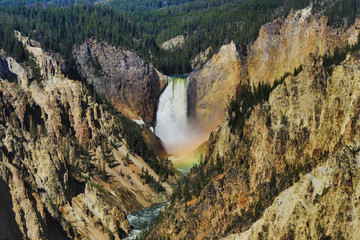 A rainbow forms in the mist of the lower falls of the Yellowstone river in Wyoming. This is the Grand Canyon of Yellowstone National Park