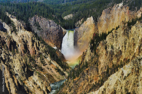 A rainbow forms in the mist of the lower falls of the Yellowstone river in Wyoming.  This is the Grand Canyon of Yellowstone National Park - 211691857