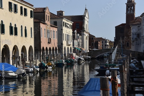Chioggia, Venice - Buildings, canals, fishing boats and tourists in the lagoon city